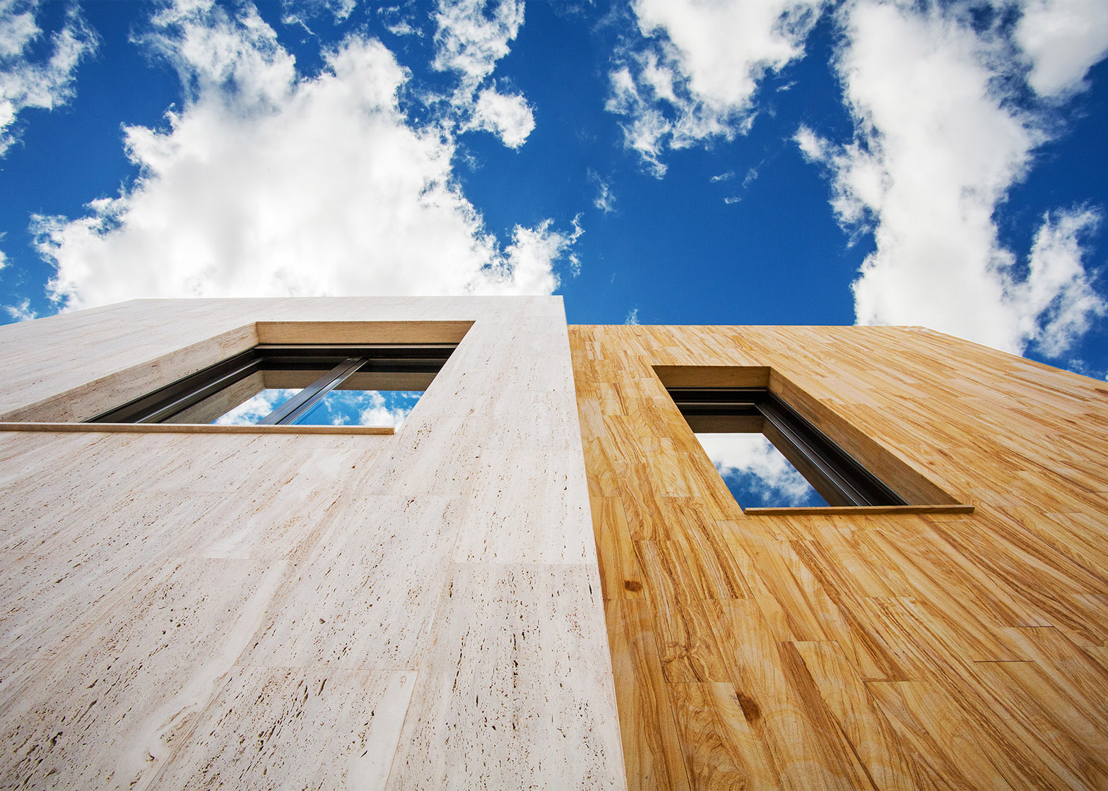 edificio mineral r + spagna rivestimenti esterni arenaria travertino ooiio architettura
